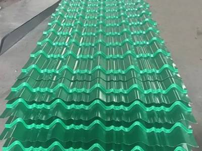 Eight pieces of green steel roof tiles piled together, they have five large corrugations and some small corrugations.